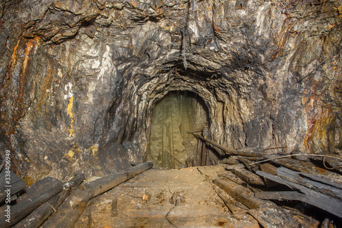 Underground abandoned bauxite ore mine tunnel incline shaft Wallpaper Mural