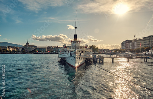 Beautiful city landscape. An old ship off the coast of Geneva. Wallpaper Mural