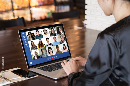 Back view of young asian business woman work remotely at home video conference remote call to corporate group Canvas Print