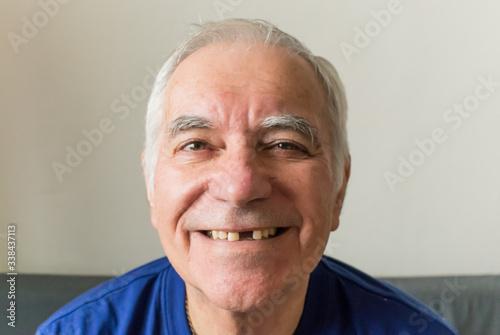 old man senior face closeup missing tooth smile proper dental care insurance hea Fototapeta
