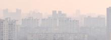 Cityscape In Smog. Silhouettes...