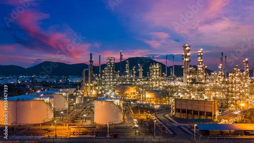 Tablou Canvas Oil and gas refinery plant and storage tank form industry zone at twilight, Aerial view oil and gas Industrial petrochemical fuel power and energy