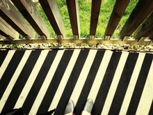 Close-up Of Cropped Shoes Against Railings With Shadow