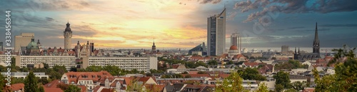 Obraz Panorama of the city of Leipzig, Saxony, with tall buildings, town hall and churches with an interesting colored sky - fototapety do salonu