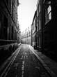 Narrow Empty Alley Along Buildings