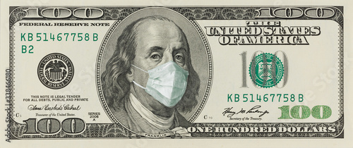 Cuadros en Lienzo A 100-dollar bill with a face mask by Benjamin Franklin from the COVID-19 Coronavirus in the United States