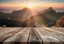 Wooden Table Top On Blurred Sunset On Mountain In Wildlife Sanctuary At Doi Luang Chiang Dao National Park