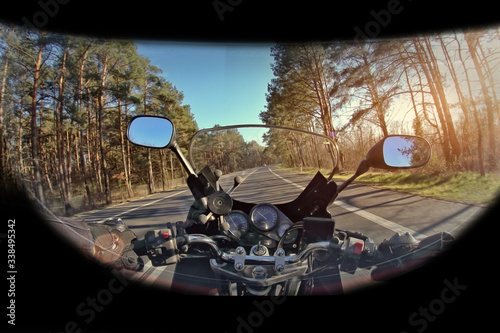 motorbike travel along the road with a view of the driver in a helmet Canvas Print