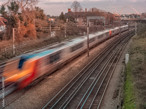 Canvas Print London Underground train passing by with Wembley Stadium in background