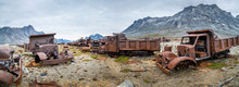 Panoramic View Of A Military Truck Graveyard In Greenland