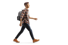 Male Student With A Backpack Walking