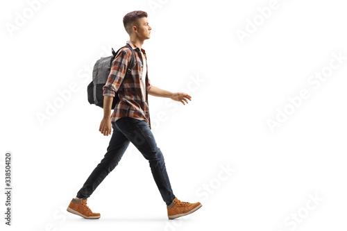 Obraz Male student with a backpack walking - fototapety do salonu