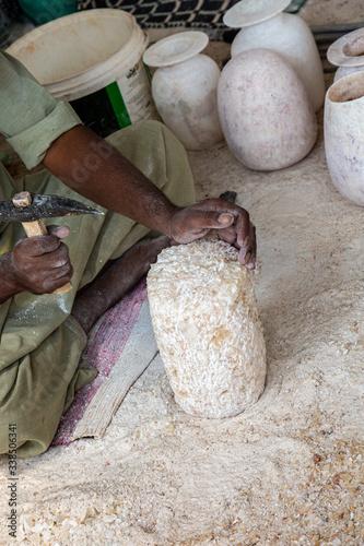 Man cut alabaster stone for vase Wallpaper Mural