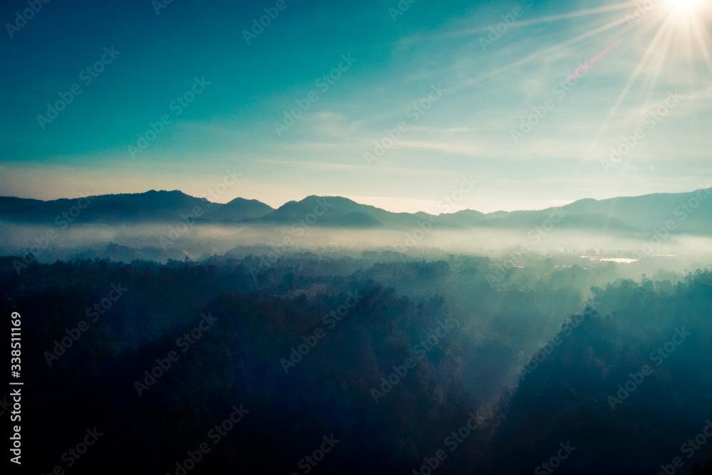 Fototapeta Mountain Landscape With Blue and Misty Sky