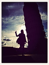 Woman Gesturing Peace Against Leaning Tower Of Pisa