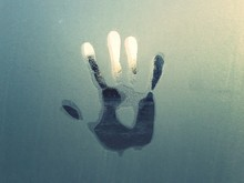 Handprint On Condensed Glass Window