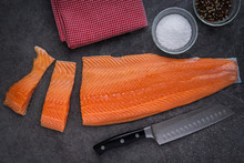 Salmon Filets Being Cut With A...