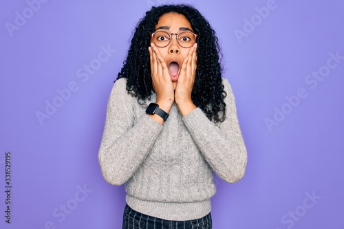 Young african american woman wearing casual sweater and glasses over purple back Wallpaper Mural