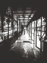 Man Walking Under Scaffolding