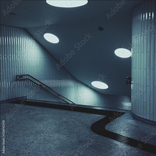 Obraz Interiors Of Illuminated Building With Staircase - fototapety do salonu