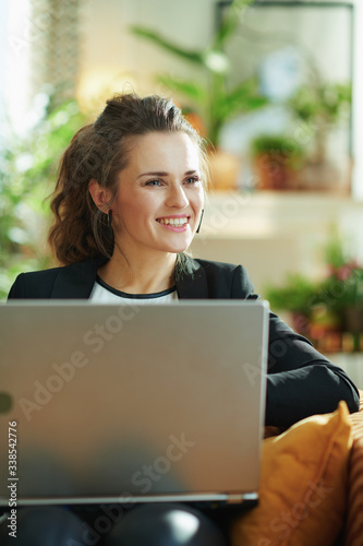 happy modern woman and surfing web while sitting on couch Canvas Print