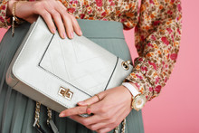 Women`s Fashion Concept: Model Holding Trendy Small Green Mint Color Faux Leather Bag, Wearing Stylish White Wrist Watch, Beautiful Rings