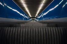 Surface Level Of Escalator With Blue Railings