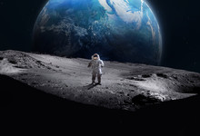 Astronaut On Surface Of The Moon. Earth On Background. Apollo Space Program. Exploration Of Moon. Dark Crater. Elements Of This Image Furnished By NASA