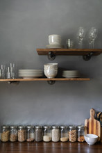DIY European Farmhouse Rustic Kitchen With Gray Lime Wash Wall And Floating Shelves