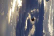 Low Angle View Of Parachute Against Clouds