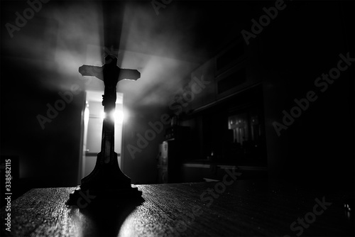 Fototapeta Close-up Of Silhouette Cross On Table obraz