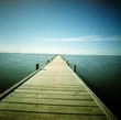 Wooden Pier Leading To Sea