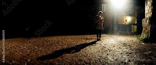 Fototapeta Illuminated Square With Person In Shade obraz