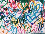 Fototapeta Młodzieżowe - Graffiti designs of multicolored hearts