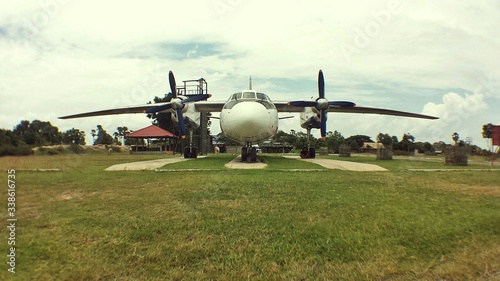 Airplane On Airbase Against Cloudy Sky Tablou Canvas