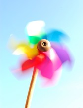 Multicolored Pinwheel Spinning Against Clear Sky