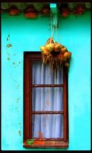 Bunch Of Onions Hanging Outside Window