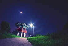 Low Angle View Of Gazebo And Street Light Against Sky At Night