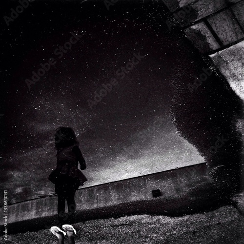 Reflection Of Girl On Puddle At Night Wallpaper Mural