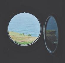 Sea Seen Through Window Of Light House