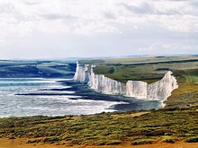 Idyllic Shot Of Cliffs At Seven Sisters Against Cloudy Sky