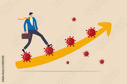 Fotografía Leadership to solve problem in Coronavirus COVID-19 crisis, walk pass and survive in economic crisis in COVID-19 outbreak, confidence business man leader walk up Coronavirus stair with graph arrow