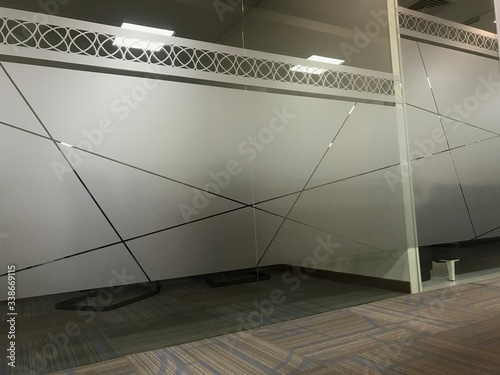 Fototapeta Images of Full height glass wall partitions for an office meeting room or manager room with an sticker of Frosted film for privacy of people for discussing in office interiors obraz