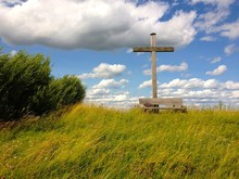 Wooden Cross And Bench On Gras...
