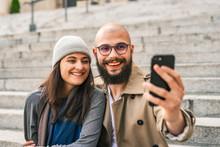 Cheerful Couple Taking Selfie ...