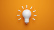 Light bulb idea concept top view on orenge background. 3D rendering