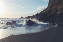Waves Crashing On Rocks At Beach