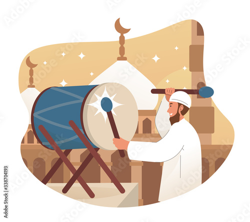 Muslim man hits drum prior to the azan (call to prayer) Wallpaper Mural