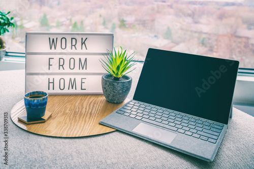 Fototapeta Working from home remote work inspirational social media lightbox message board next to laptop and coffee cup for COVID-19 quarantine closure of all businesses