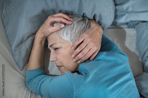 Mature Woman in Bed, Staying Awake Late at Night, Having Sleeping Problems Canvas Print